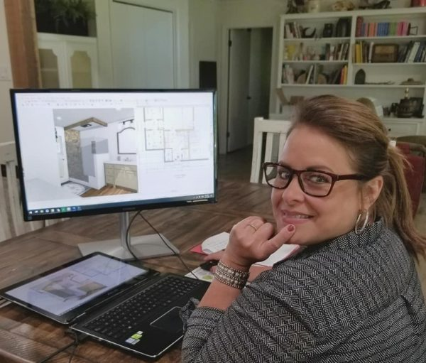 Lisa Willard at Ashley's Building and Construction HQ working on a bathroom remodel design.